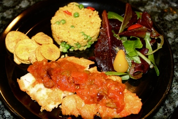Fish in mojo islena sauce, yellow rice, salad and plantain chips